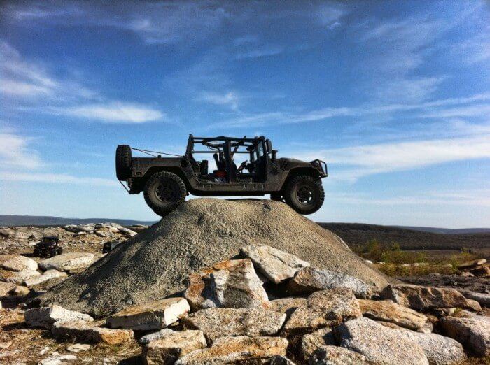 Hummer on-top of a hill